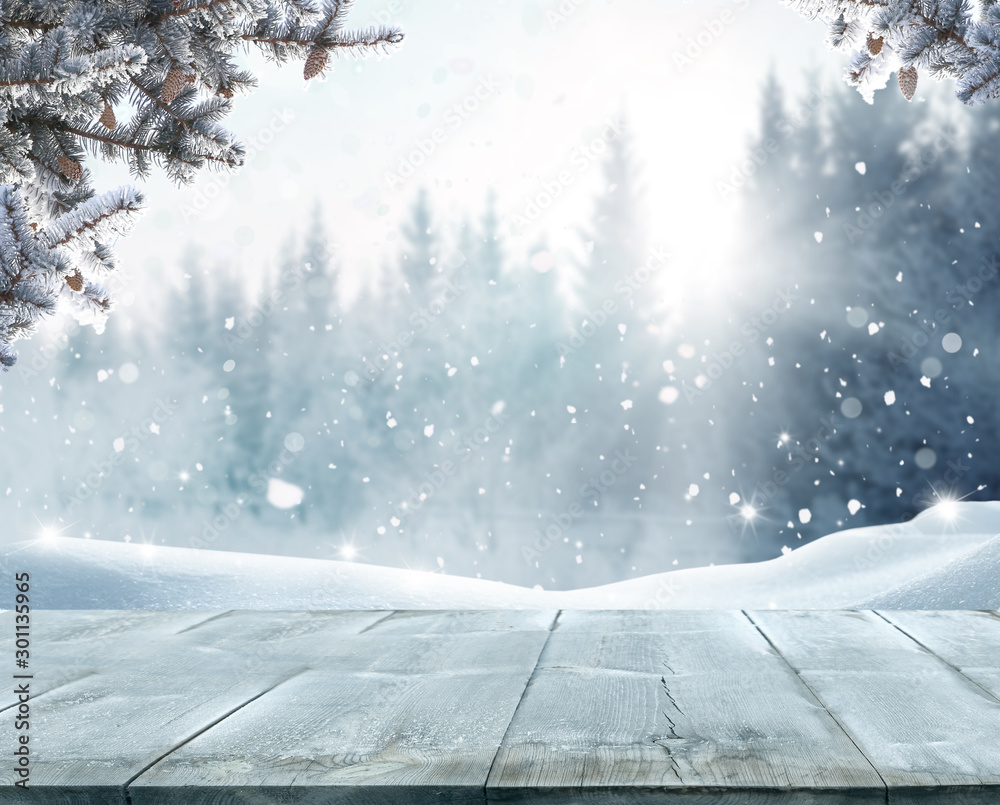 Fototapeta Merry Christmas and happy New Year greeting background with table .Winter landscape with fir tree branch