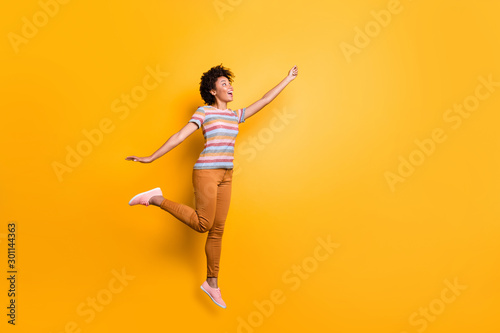 Cuadros en Lienzo  Side profile full length body size photo of cheerful excited positive nice prett