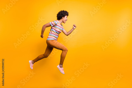 Full size profile photo of jumping high dark skin wavy lady speed race running c Wallpaper Mural