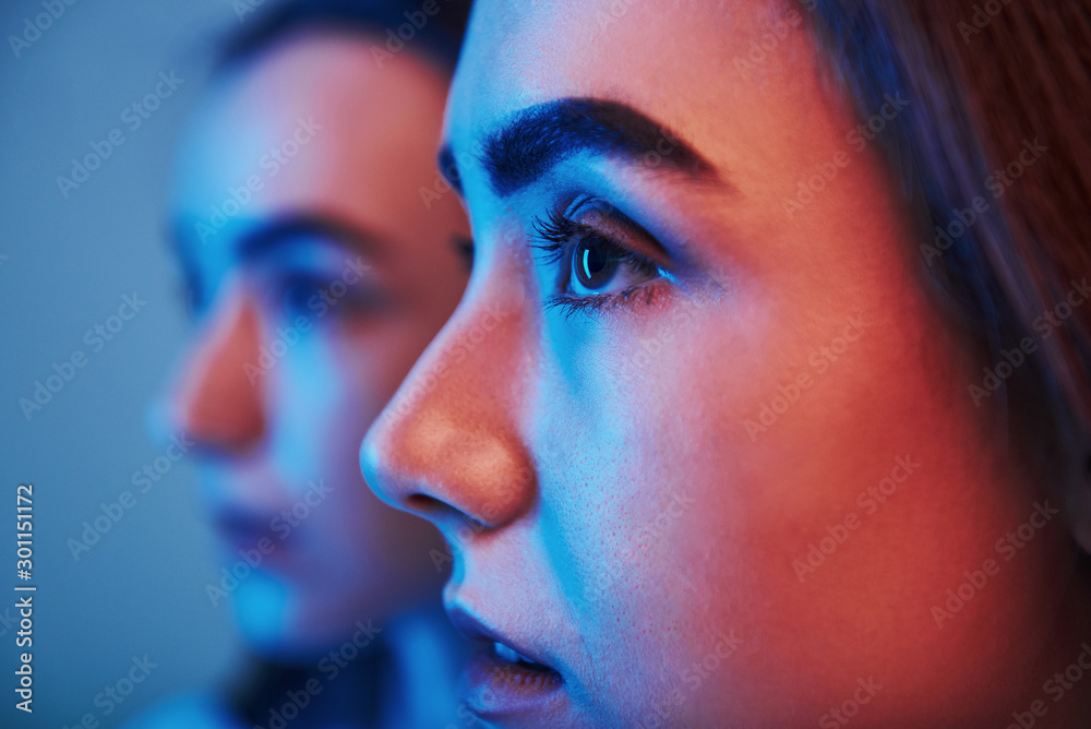 Fototapety, obrazy: Futuristic conception. Studio shot indoors with neon light. Photo of two beautiful twins