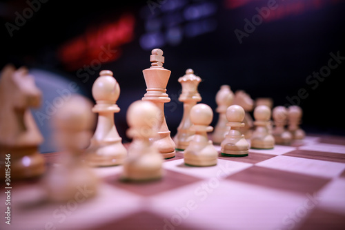 Shallow depth of field (selective focus) image with wooden chess pieces on a wooden table before a professional competition Canvas Print