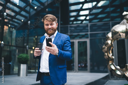 Half length portrait of cheerful male entrepreneur with takeaway cup with tasty Canvas-taulu
