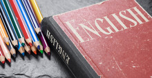 Learning English Concept. Dictionary With Pencils