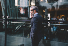 Businessman Talking On Phone In Fitting Well Suit