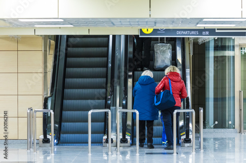 People on the escalator or moving staircase with inscription departure in Englis Canvas-taulu