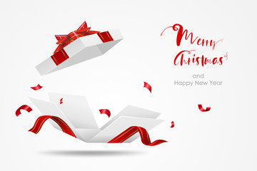 Surprise white gift box with red ribbon.  Open gift box isolated. Merry Christmas and Happy New Year.