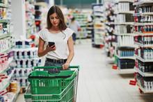Using Smartphone. Female Shopp...