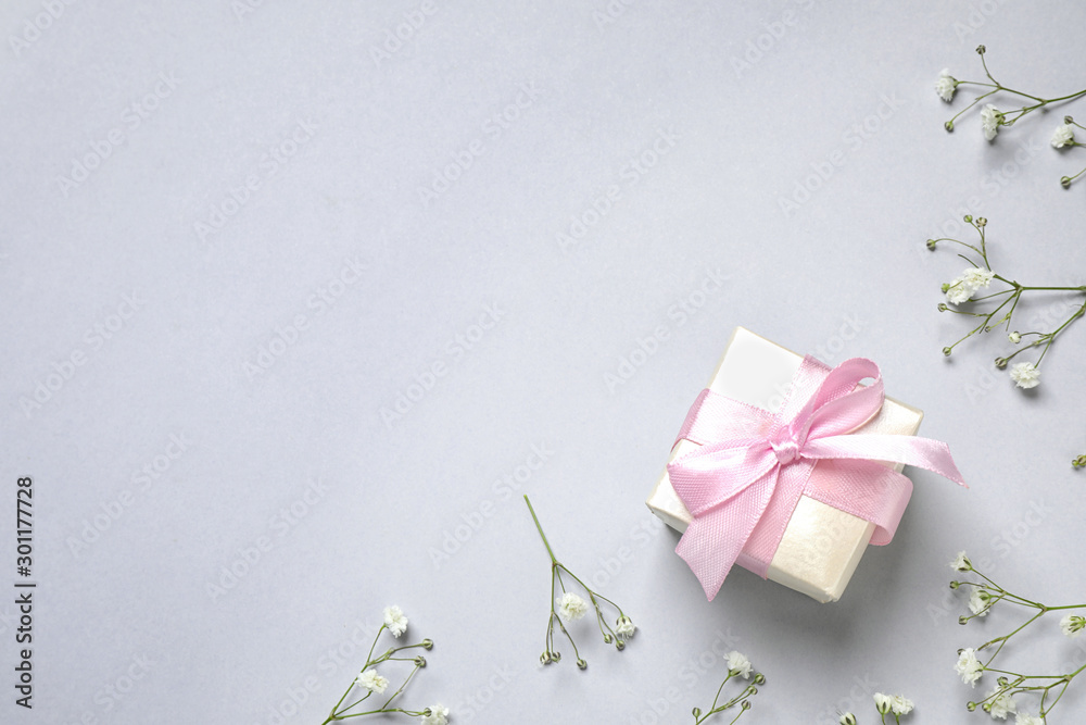 Fototapety, obrazy: Flat lay composition with flowers and gift on light grey background, space for text. Happy Mother's day