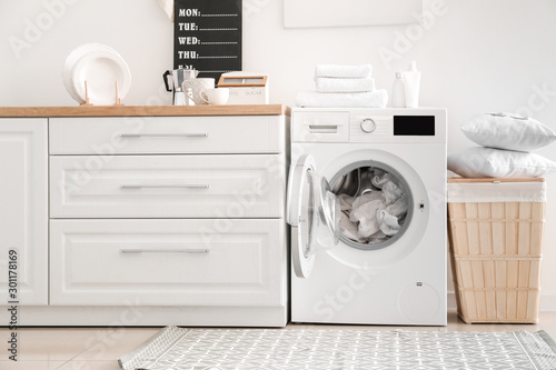 Interior of kitchen with modern washing machine