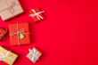 canvas print picture - Photo of creative concept of new year preparation gift boxes next empty space isolated red vibrant color background