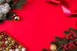 canvas print picture - Top above high angle view photo of empty space with toys branches of fir tree toys tinsel surrounding isolated red color vivid background
