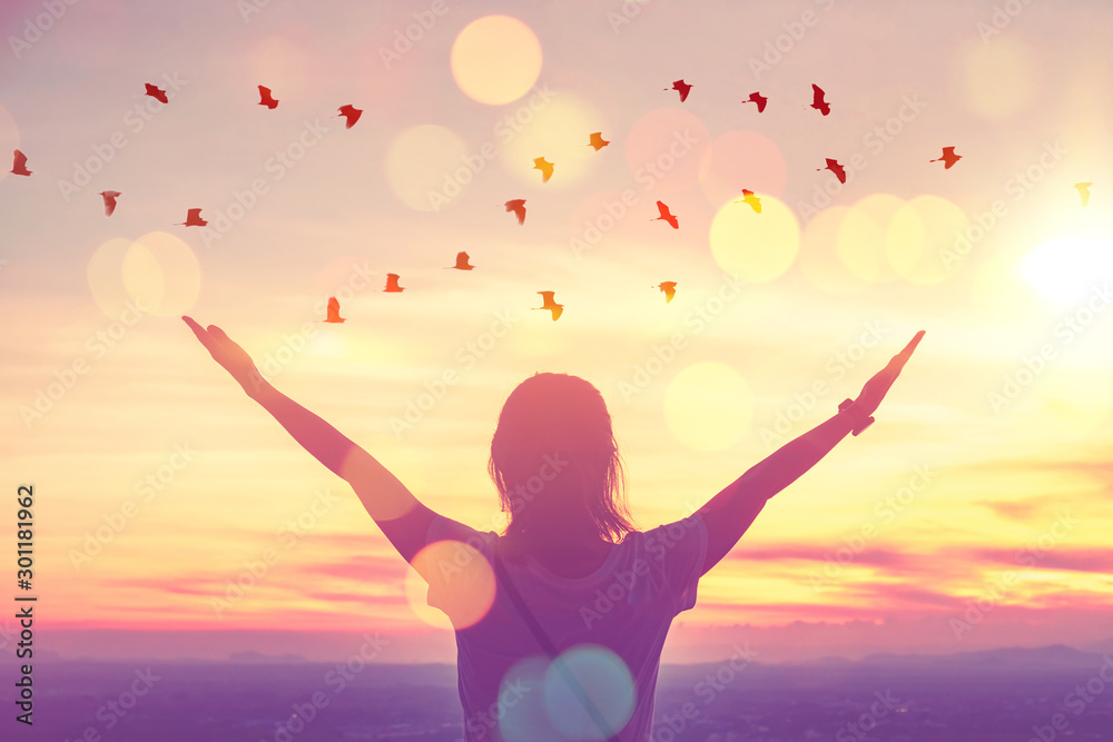 Fototapety, obrazy: Freedom feel good and travel adventure concept. Copy space of silhouette woman rising hands on sunset sky at top of mountain and bird fly abstract background.