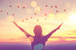 canvas print picture - Freedom feel good and travel adventure concept. Copy space of silhouette woman rising hands on sunset sky at top of mountain and bird fly abstract background.