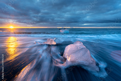 little Icebergs at sunrise in Jokulsarlon glacial lagoon Wallpaper Mural