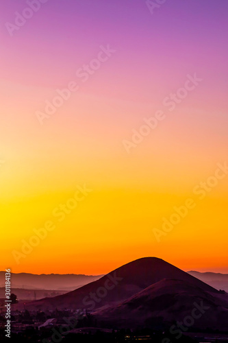 Pastel Sunset in the Silhouetted Mountain