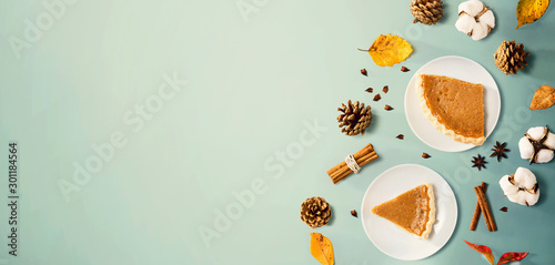 Autumn theme with pumpkin pies - overhead view - 301184564