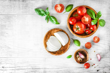 Fresh Finest Tomatoes On White Rustic Board With Basil And Mozzarella Cheese Top View.