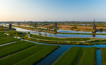 Aerial View Of Windmills In The Kinderdijk Area During Sunset. Spring In Holland