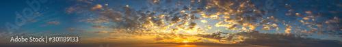 Foto auf Gartenposter Blaue Nacht Panorama Sunlight with dramatic sky. Cumulus sunset clouds with sun setting down on dark background.Vivid orange cloud sky.