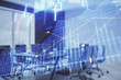 Double exposure of forex chart on conference room background. Concept of stock market analysis