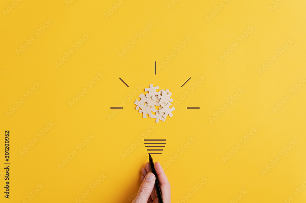 Fototapeta Light bulb over yellow background in vision and idea conceptual image