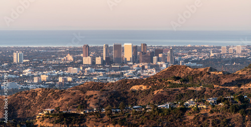Morning panorama view of Century City and Beverly Hills with the Pacific Ocean in background.  Shot from mountaintop near popular Griffith Park in Los Angeles, California.   #301212194