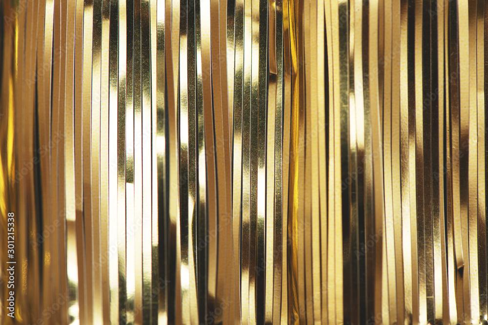 Fototapety, obrazy: Golden foil tinsel strips.