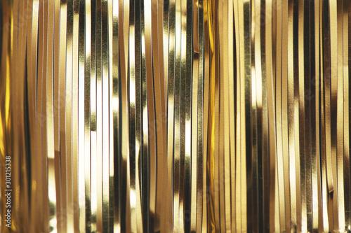 Obraz Golden foil tinsel strips. - fototapety do salonu