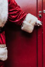Santa Claus Gloved Hands Open The Door, Close Up