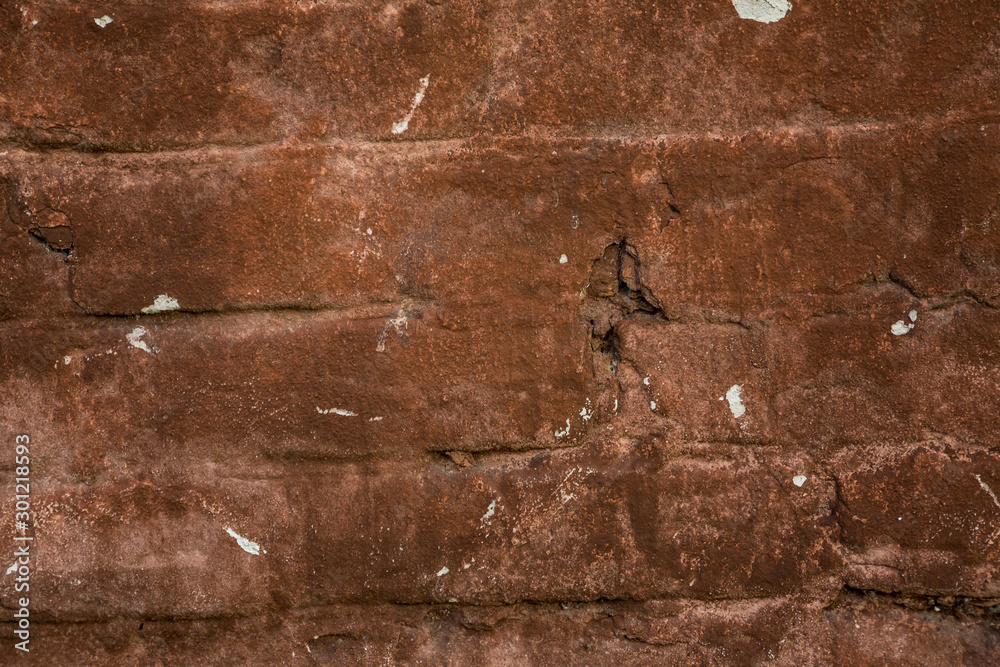 Fototapety, obrazy: Old red brick wall with scratches and corrosion on it.