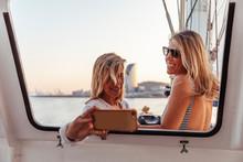 Friends During Boat Trip Takin...