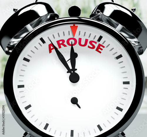 Photo Arouse soon, almost there, in short time - a clock symbolizes a reminder that Ar