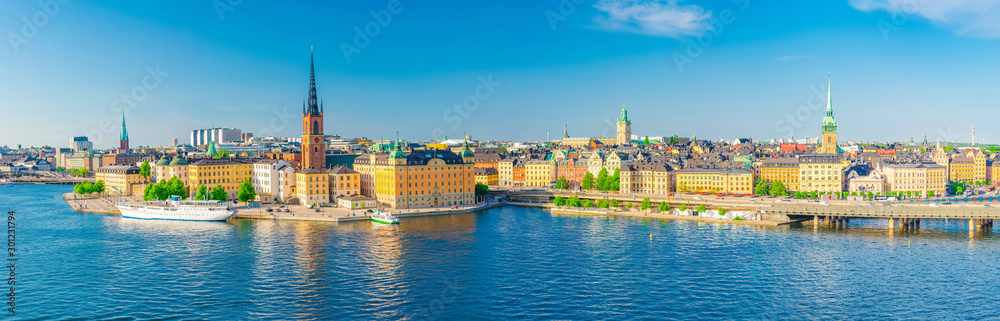 Fototapety, obrazy: Aerial scenic panoramic view of Stockholm skyline with Old town Gamla Stan, typical Sweden houses, Riddarholmen island with gothic Church building, Lake Malaren, clear blue sky background, Sweden