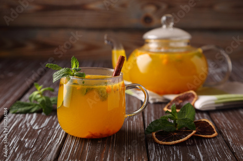 Hot sea buckthorn tea with mint, cinnamon and honey, a delicious preventive measure for colds, and to strengthen the immune system Wallpaper Mural