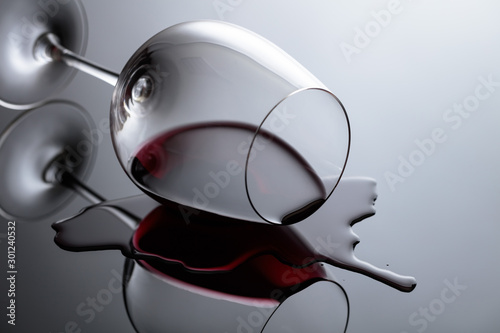 Glass of red wine on a black reflective background. Wallpaper Mural