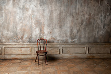 Chair On Vintage Wall Background
