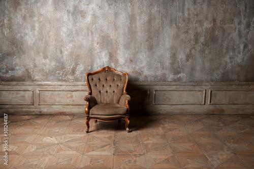 Fotografia, Obraz old armchair against a vintage wall