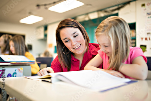Fotografiet  education and school concept little student girl studying at school