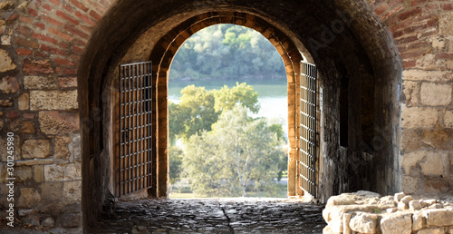 view through one of the gates, made in brick and stone wall, on Kalemegdan fortress, Belgrade, Serbia