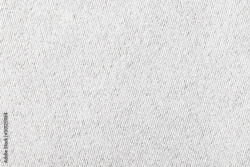Foto auf Leinwand Makrofotografie White canvas texture. Bright fabric material background.
