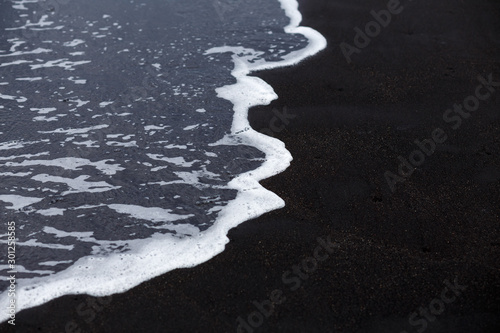 Ocean wave at black sand beach in Iceland. Nature background