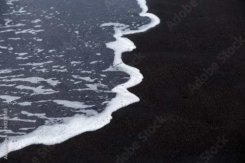 Obraz Ocean wave at black sand beach in Iceland. Nature background - fototapety do salonu