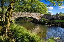 Stone Arch Pelter Bridge In Evening Sun Over The River Rothay At Rydal Ambleside Lake District National Park England