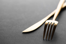 Gold Cutlery Set On Black Back...