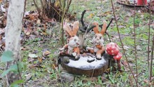 Toys Hares In The Garden On A Stump.snow Forest Mushrooms Decoration.