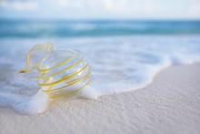Clear Christmas Glass Ball On Beach