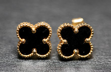 Small Black Clover Earrings On White Background. - Image