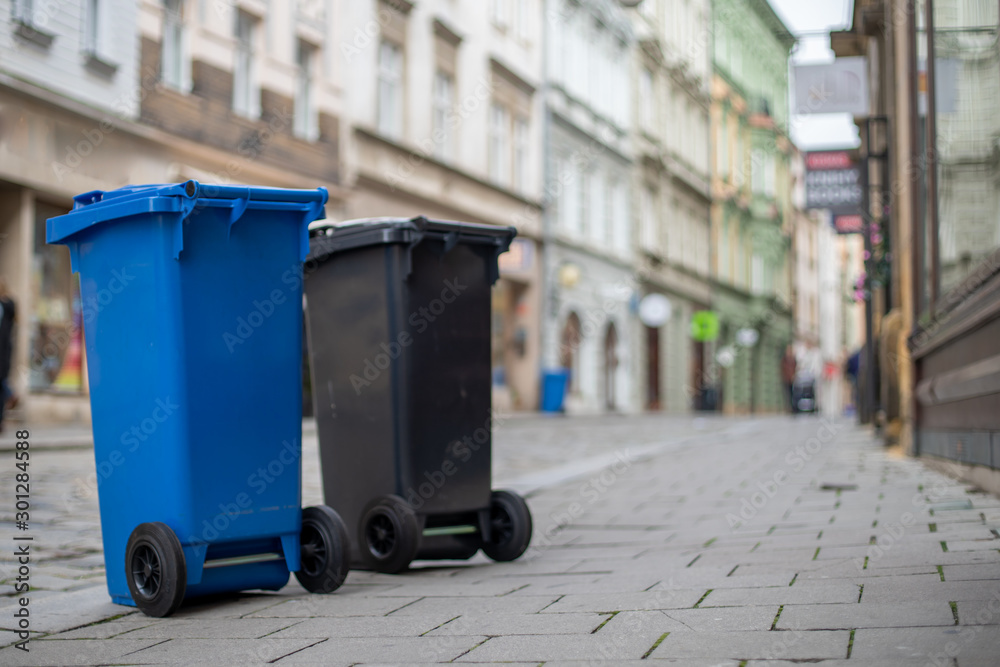 Fototapeta Waste bins in the city for order and cleanliness on the streets