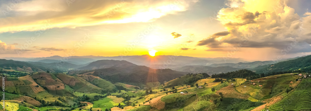 Fototapety, obrazy: Aerial shot of the marvelous teraces rice field in mountains during sunset in Thailand. Beautiful Pa Bong Piang terraced rice fields, Mae Chaem, Chiang Mai Thailand in harvest season.