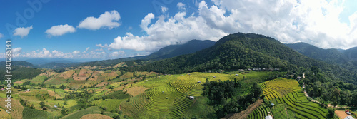 Autocollant pour porte Les champs de riz Aerial shot of the marvelous teraces rice field in mountains during sunset in Thailand. Beautiful Pa Bong Piang terraced rice fields, Mae Chaem, Chiang Mai Thailand in harvest season.